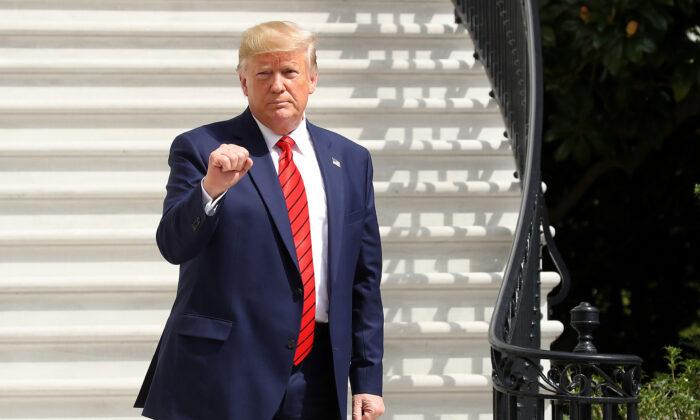 Trump fist pumps 700x420