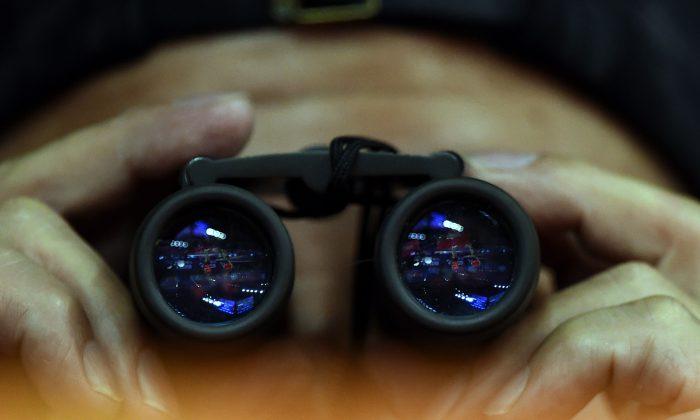 Chinese binoculars spying Johannes Eisele Getty Images 700x420