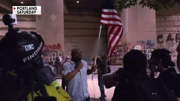 Black Marine vet holds US flag high amid chaotic Portland protest, gets followed home by Antifa