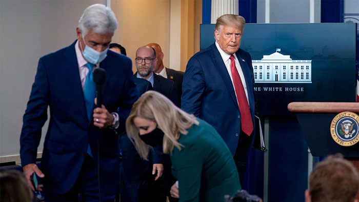 Trump abruptly escorted out of White House press briefing, returns to say there was a 'shooting' outside