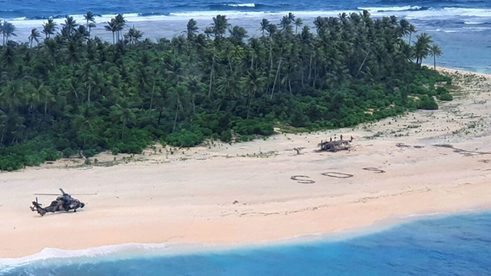Missing sailors rescued from Pacific island after SOS signal spotted in the sand