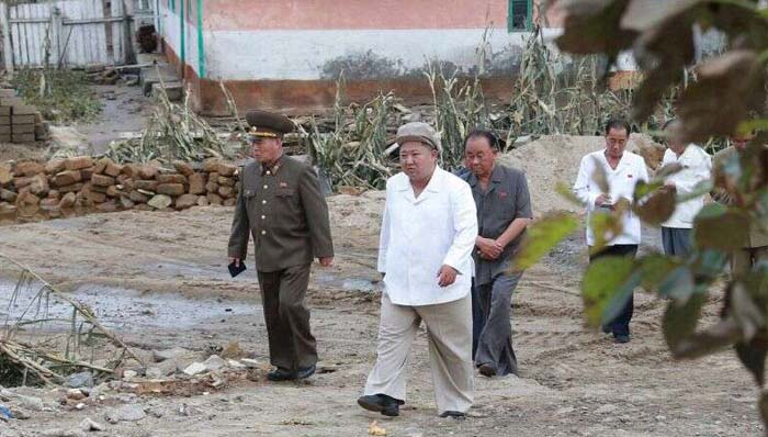 North Korea's Kim Jong Un visits typhoon-hit area after local officials threatened with 'punishment' over storm deaths